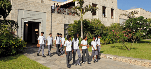 Kids walking out of a building at the Aga Khan Academy in Mombasa. (Photo: AKDN)